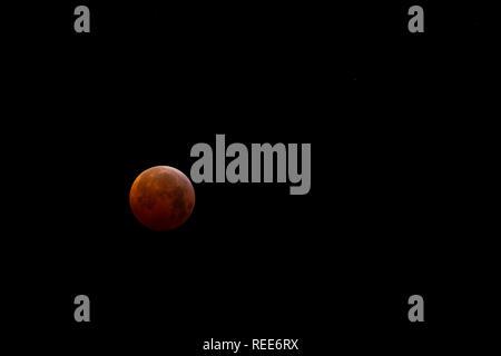 beautiful red full moon eclipse January 2019 in switzerland - Stock Photo