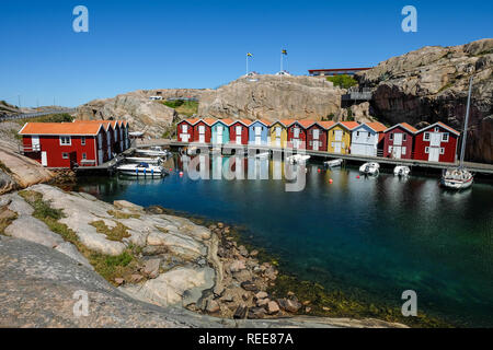 little colorful boat houses at Smögen. a must see travelspot at the westcoast of sweden. - Stock Photo