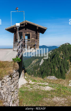 Unusually with overhang built small weather and observation station with position near the mountain station of the Tegelbergbahn in Bavaria with blue  - Stock Photo