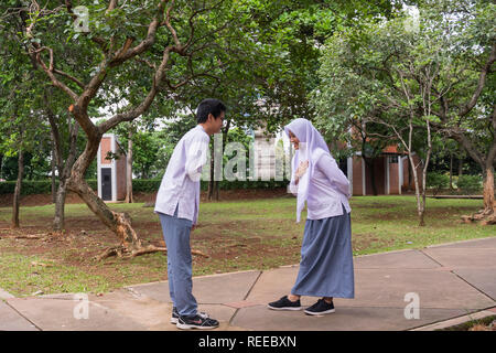 1.18, Facing each other, IndonesianBook - Stock Photo