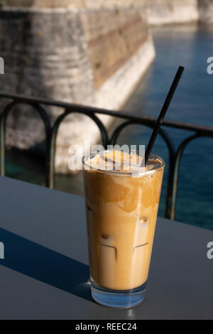 Greece Corfu Iced coffee at the Aktaion bar and cafe by the Old Fortress in Corfu Town - Stock Photo