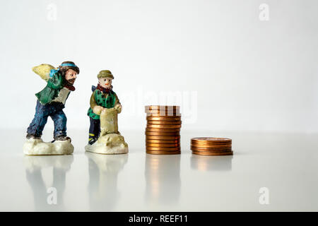 stack of coins with worker figures on white background Working for pennies cents concept Low salary - Stock Photo