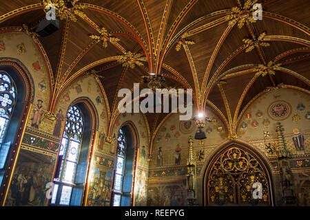 Interior of the city hall of Bruges showing the Gothic hall with polychrome vault and 19th century murals, West Flanders, Belgium - Stock Photo