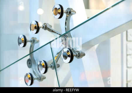 Architecture abstract background. Glass curtain walls. Metal fasteners elements of spider glass system. Facade detail Windows - Stock Photo
