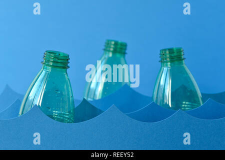 Plastic bottles floating on water - Sea pollution concept - Stock Photo