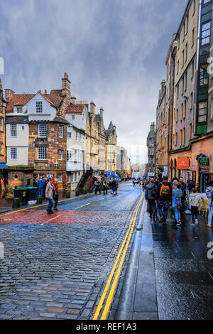 Edinburgh, Scotland - August 14, 2018:  Pedestrians walk along the Royal Mile, a sequence of streets forming the main thoroughfare of the Old Town of - Stock Photo