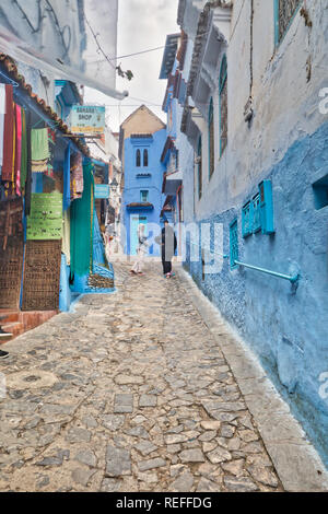Chefchaouen, Morocco - November 2, 2018: Picturesque street of the medina of Chefchaouen, known as the blue village, a beautiful and touristic village - Stock Photo