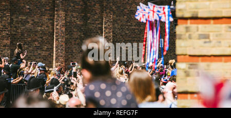 WINDSOR, BERKSHIRE, UNITED KINGDOM - MAY 19, 2018: Royal carriages approaces - taking photos of royal wedding of Prince Harry and Meghan Markle - Stock Photo