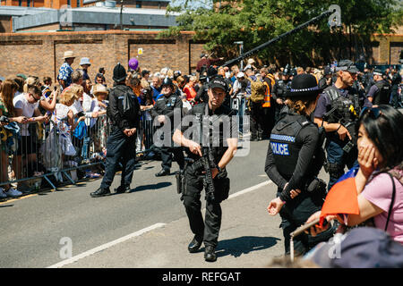 WINDSOR, UNITED KINGDOM - MAY 19, 2018: Police man with rifle gun security at royal wedding marriage celebration of Prince Harry, Duke of Sussex and the Duchess of Sussex Meghan Markle - Stock Photo