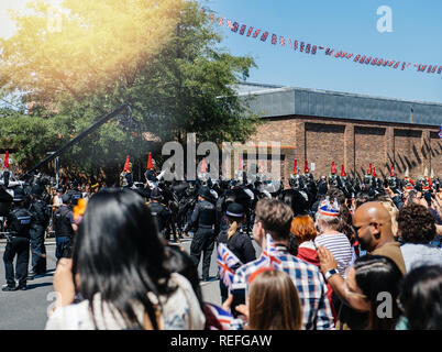 WINDSOR, UNITED KINGDOM - MAY 19, 2018: Saluting the Royal Guards march in street around Windsor Castle prior to procession celebrate wedding of Prince Harry of Wales and Ms Meghan Markle - Stock Photo