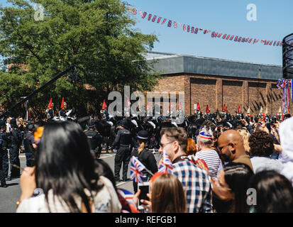 WINDSOR, UNITED KINGDOM - MAY 19, 2018: Majestic Royal Guards march in street around Windsor Castle prior to procession celebrate wedding of Prince Harry of Wales and Ms Meghan Markle - Stock Photo