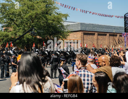 WINDSOR, UNITED KINGDOM - MAY 19, 2018: Silhouettes of Royal Guards march in street around Windsor Castle prior to procession celebrate wedding of Prince Harry of Wales and Ms Meghan Markle - Stock Photo