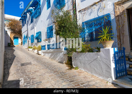 Cityscape with typical white blue colored houses in resort town Sidi Bou Said. Tunisia, North Africa. - Stock Photo