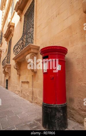 A 'British' letter box outside the Tourist Information Office in Merchants Street in Valletta, Malta. - Stock Photo
