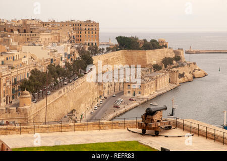 View of the walled city of Valletta, the Grand Harbour and the Saluting Battery from Upper Barrakka Gardens in Malta. - Stock Photo