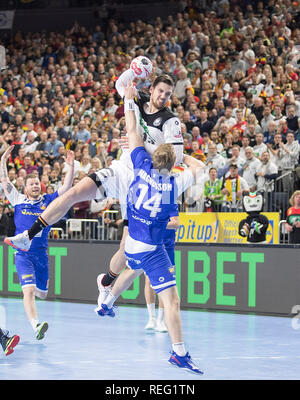 Cologne, Deutschland. 19th Jan, 2019. Jumping Hendrik PEKELER behind (GER), action, goal throw, versus Omar Ingi MAGNUSSON (ISL), main round group I, Germany (GER) - Iceland (ISL) 24 - 19, on 19.01.2019 in Koeln/Germany. Handball World Cup 2019, from 10.01. - 27.01.2019 in Germany/Denmark. | usage worldwide Credit: dpa/Alamy Live News - Stock Photo