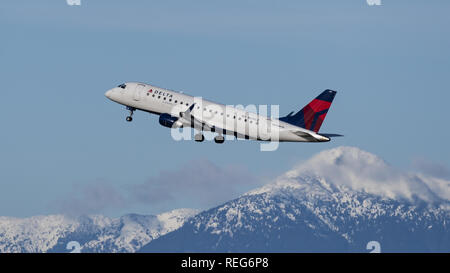 Richmond, British Columbia, Canada. 20th Jan, 2019. A Delta Connection (Compass Airlines) Embraer 175 (N619CZ) jet airliner airborne after take-off. The airliner is owned and operated by Compass Airlines and flies under contract to Delta Air Lines. Credit: Bayne Stanley/ZUMA Wire/Alamy Live News - Stock Photo