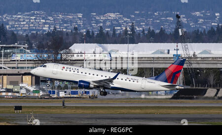 Richmond, British Columbia, Canada. 20th Jan, 2019. A Delta Connection (Compass Airlines) Embraer 175 (N619CZ) jet airliner takes off from Vancouver International Airport. The airliner is owned and operated by Compass Airlines and flies under contract to Delta Air Lines. Credit: Bayne Stanley/ZUMA Wire/Alamy Live News - Stock Photo