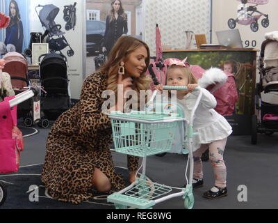 Olympia London, UK. 22nd Jan 2019. Amy Childs, TV star and Celebrity Mum of the Year with her daughter Polly showcase the new range of Doll Pram at London Toy Fair 2019 in Kensington Olympia, London, UK Credit: Nastia M/Alamy Live News - Stock Photo
