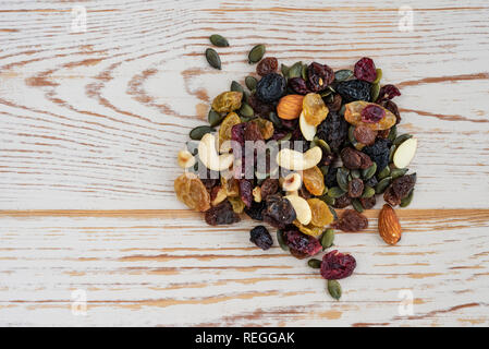 Mixture of dried fruits, nuts and seeds. Trail mix nutrition. - Stock Photo