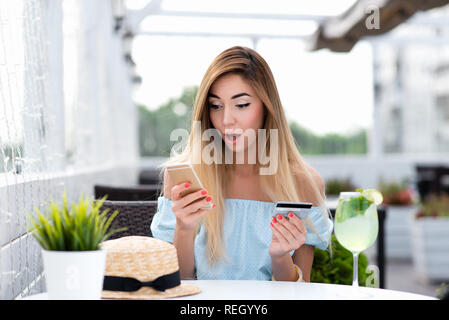 Girl cafe in summer. Pay breakfast and lunch with plastic card by phone via Internet application. Emotion of surprise, shocked valuable product. Concept of misunderstanding confusion big write-off. - Stock Photo