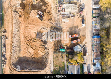 aerial top view of construction site with heavy industrial machinery for ground work - Stock Photo