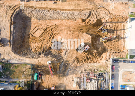 aerial top view of ground foundation works at city construction site - Stock Photo