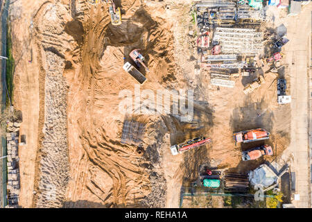various heavy building machines working at construction site. aerial top view - Stock Photo