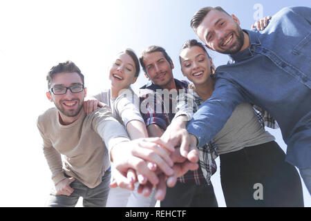College Students Teamwork Stacking Hand Concept - Stock Photo