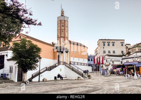 Chefchaouen, Morocco - November 4, 2018: The Great Mosque, located in Outa El Hamam Square, is the main mosque of Chefchaouen - Stock Photo
