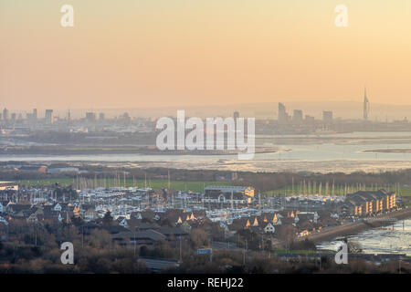 Sunset view from Portsdown Hill at dusk over Portsmouth and Port Solent and the Portsmouth skyline in the distance, Portsmouth skyline, Hampshire, UK - Stock Photo