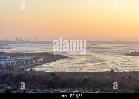 Sunset view from Portsdown Hill at dusk over Paulsgrove Lake and Port Solent and the Spnnaker Tower in the distance, Portsmouth skyline, Hampshire, UK - Stock Photo