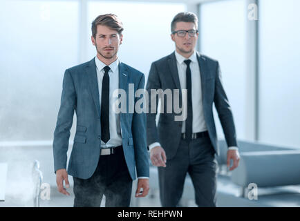 young engineers in the office, smoke - Stock Photo