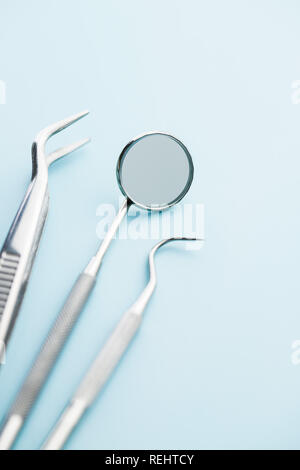 Dental instruments. Dentists tools on blue background. - Stock Photo