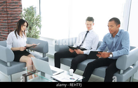business team studying working papers, sitting in the office - Stock Photo