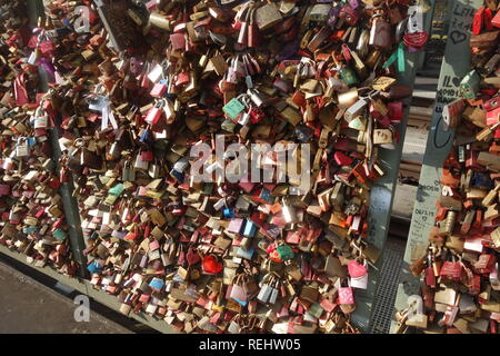 The Hohenzollern Bridge in Cologne, West Germany, which famously features thousands of love locks. - Stock Photo