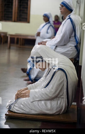 Statue of Mother Teresa in chapel of Mother House, the headquarters for the Missionaries of Charity - Stock Photo