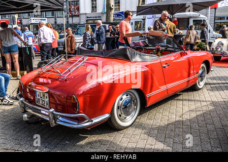 GERMANY, LIMBURG - APR 2017: red VW VOLKSWAGEN KARMANN-GHIA TYP 14 CONVERTIBLE CABRIO 1955 in Limburg an der Lahn, Hesse, Germany. - Stock Photo