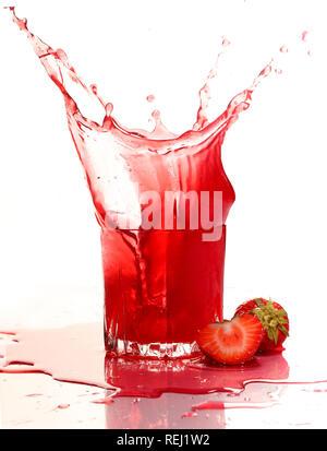 Strawberry juice on a white background - Stock Photo