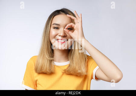 Asian young Businesswoman with ok sign gesture. - Stock Photo