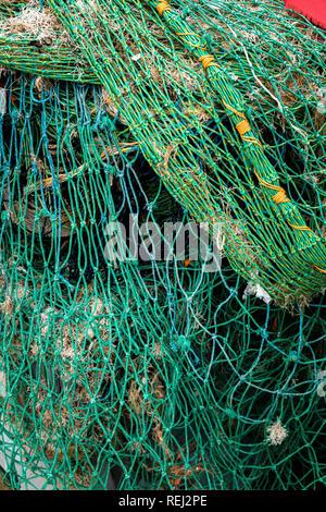 Bundle of Fishing Boat Nets on Quayside from fishing trawler - Stock Photo