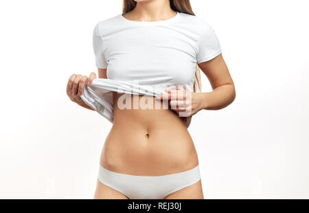 Pregnant woman pregnancy concept heart on stomach. Hands forming heart on female belly button. - Stock Photo
