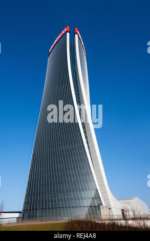 Full length view of the Generali Tower, Milan by architect Zaha Hadid with a modern design warping on its axis in a graceful curve - Stock Photo