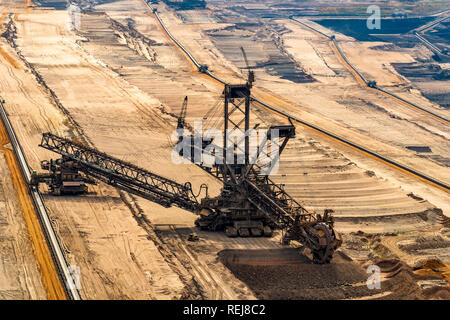 ELSDORF, NRW, GERMANY - AUGUST 12, 2018: Mining excavator in lignite mine Hambach. Showing degradation of fossil brown coal - Stock Photo