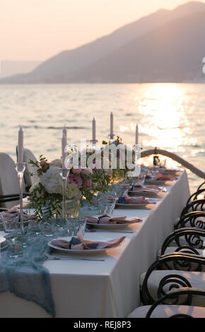 beautifully decorated table with flowers for wedding dinner - Stock Photo
