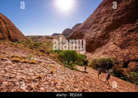 People walking under blazing sun on hot summer sunny day in the Olgas NT central outback Australia - Stock Photo