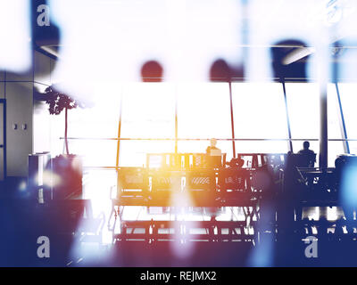Double exposure with silhouettes of passengers in the airport waiting for boarding - Stock Photo