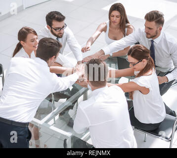 business team is making a tower out of hand - Stock Photo
