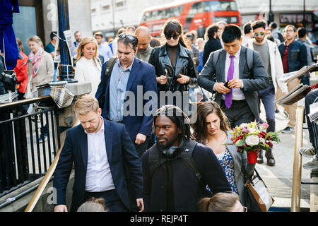LONDON, UNITED KINGDOM - MAY 18, 2018: Cinematic Oxford Circus Station people descending metro station on a busy evening - Stock Photo