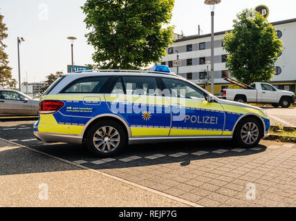 BADEN, GERMANY - MAY 11, 2018: Polizei Police car Mercedes-Benz blue car parked in front of Karlsruhe Baden-Baden Airport (IATA: FKB, ICAO: EDSB) - Stock Photo